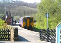 View from the bottom of the footbridge stairs at Grosmont on 20 April 2009 as the Northern 10.38 <I>Esk Valley Line</I> DMU from Middlesbrough arrives at platform 1 on a service to Whitby.<br><br>[John Furnevel&nbsp;20/04/2009]