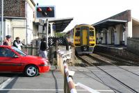 A Northern 158 clears River Head Drive level crossing and pulls into Driffield station on 1 October 2008 with the late running 07.39 Gilberdyke - Scarborough service.<br><br>[John Furnevel&nbsp;01/10/2008]