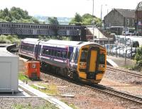 A southbound 158 arrives at Larbert on a bright and sunny afternoon in July 2008. <br><br>[John Furnevel&nbsp;03/07/2008]