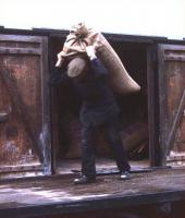 The way it used to be. Offloading sacks of malt from rail vans at Tain good yard in 1974, ready for delivery by NCL lorry to Glenmorangie distillery. The photographer - who was working on the railway in his student holidays - will not forget the ensuing trip to the distillery to help the lorry driver offload the malt. Job completed, the two were ushered into the bowels of the distillery, an official unlocked a tall cupboard and then ceremoniously poured each of them an exceedingly large dram. This was the generous practice afforded to all delivery men in those distant days!<br><br>[David Spaven&nbsp;//1974]