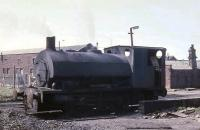 A battered looking 0-4-0ST still in steam in 1968 at the Ladysmith Washery serving the colliery near Whitehaven. [I would be pleased to receive any information about this engine, including whether the shortened chimney was an accident or rough modification!]<br><br>[David Hindle&nbsp;//1968]