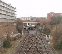 Bury Interchange, now over thirty years old, as seen from an ELR train passing over <I>The Hump</I> on the Heywood line that replaced the flat crossing at Bury Knowsley Street. Originally used by Bury line EMU services the Interchange was converted to Metrolink operation in 1992 and a tram can be seen in one of the platforms. The pointwork in the foreground is needed for the six minute frequency service that is in operation on most days. [See image 24666] <br><br>[Mark Bartlett&nbsp;01/01/2011]
