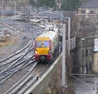 Wallneuk Junction is immediately to the east of Paisley Gilmour Street station and is where the Inverclyde lines part company from the Glasgow & Paisley line.� On 4 January 334 021 sticks to the Ayrshire line with a service for Ayr, and will call at Platform 4 at Gilmour Street.<br> <br><br>[David Panton&nbsp;04/01/2011]