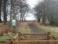 The start of the public footpath section of the old tramway to Ettrick Bay photographed in December 2010. This electrified extension of the former Rothesay to Port Bannatyne horse tramway opened in 1905. In 1931 ownership transferred to Scottish Motor Traction, who immediately cancelled winter services. The double track line closed completely five years later.<br><br>[Mark Bartlett&nbsp;28/12/2010]