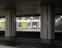 A study in beige: looking across the tracks at Partick subway station on 4 January.� The decor is stuck in the late 1970s when the Subway was modernised.� Adding to the period feel is an advertising poster featuring a Polaroid (TM) camera.� It would add even more to the period feel if I could report that behind one of the pillars was a bloke with a Zapata and flares, but in fact I was entirely alone...<br> <br><br>[David Panton&nbsp;04/01/2011]