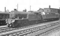 Gresley V1 no 67665 and EE Type 4 no D255 photographed together alongside Heaton shed in June 1961. This is the same month the locomotive was withdrawn from St Margarets shed and is presumably here on its way to Darlington Works for scrapping.<br><br>[K A Gray&nbsp;18/06/1961]