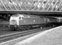 47549 brings a down special under Holgate Bridge and past the old racecourse excursion platform at York in July 1980. The train is about to take the York station avoiding line.<br><br>[John Furnevel&nbsp;13/07/1980]