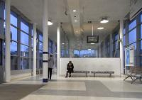 Widely-spaced but strong luminaires create interesting lighting effects in the rebuilt Partick station of 2009.� This is the eastbound waiting hall, looking west on 4 January.� It was clearly built to handle more people than on this occasion.<br> <br><br>[David Panton&nbsp;04/01/2011]