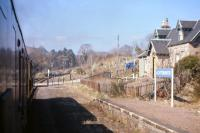 The level crossing and closed station at Achterneed seen from the 10.40 Inverness-Kyle train on Saturday 13th April 1968, as it battles into the 1 in 50 gradient towards the Ravens Rock summit. <br><br>[Frank Spaven Collection (Courtesy David Spaven)&nbsp;13/04/1968]