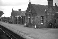 Newtonmore in late 1967 - before the station was destaffed, the main building sold off, the platform shifted eastwards, the loop lifted and the signal box closed. Not much more to 'rationalise' then! [See image 6118]<br> <br><br>[David Spaven&nbsp;//1967]