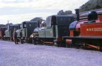 A line up of Isle of Man Railway motive power on display at Douglas station in 1969. Even at this time several of these locomotives were non-operational. Nearest the camera is the unique Manx Northern Railway 0-6-0T No. 15 <I>Caledonia</I> and in front of that the oldest locomotive in the fleet, 2-4-0T No. 1 <I>Sutherland</I>. Ahead of No. 1 are three further locomotives that appear to be No. 8 <I>Fenella</I>, No. 6 <I>Peveril</I> and an unidentified example in maroon livery.  <br><br>[David Hindle&nbsp;//1969]