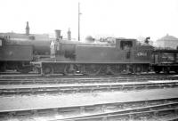 C15 no 67460 stands in the yard at Eastfield on 25 July 1959. This was one of the push-pull locomotives used on the Craigendoran - Arrochar service for many years along with classmate 67474. [See image 24286]<br><br>[Robin Barbour Collection (Courtesy Bruce McCartney)&nbsp;25/07/1959]