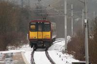 314206 departing Whinhill for Wemyss Bay on a snowy 12th January 2011. At one time there were two running lines here, with the second down line passing through the area on which the station now stands. [see image 9586]<br><br>[Graham Morgan&nbsp;12/01/2011]