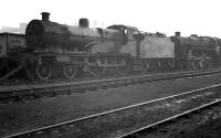 Locomotives in the sidings alongside Derby Works, thought to have been photographed in March 1958. The numbers are unreadable but the Compound is most likely no 40928, which was withdrawn from Saltley shed and scrapped at Derby that same month. The Caprotti standard class 5 is probably awaiting attention in the works.<br><br>[K A Gray&nbsp;/03/1958]