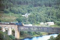 A train on the Far North line about to cross the Oykel Viaduct over the Kyle of Sutherland between Invershin and Culrain in 1975. <br><br>[Ian Dinmore&nbsp;//1975]