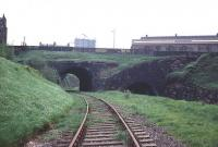 View west from the site of Greenock Lynedoch station in June 1969. Scheduled passenger services over this route, which ran to Princes Pier, were withdrawn in 1959, although boat train traffic continued until 1965. It was used latterly to handle container traffic, prior to final closure in 1991. The line through the bridge to the right ran to the large Lynedoch goods depot which was located at a lower level and is now the site of Lynedoch Industrial Estate. <br><br>[Colin Miller&nbsp;/06/1969]