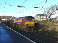 DBS locomotive 66155 powers through Ardrossan South Beach station with heavy haul train 6G07 fully loaded Hunterston HL sidings-Longannet power station.<br><br>[Ken Browne&nbsp;19/01/2011]