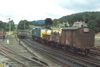 The Perth - Blair Atholl pick-up goods at Pitlochry in 1972. Class 26 no 5340 is backing the leading part of its train past some coal wagons prior to shunting them into the sidings on the left.� <br><br>[Bill Roberton&nbsp;//1972]