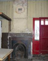 Interior of the wooden station building at King Edward on 22 January 2011. The owner kindly let me grab this shot through a window which shows the original 1872 chimney and fireplace still in situ. [See image 32456.]<br><br>[John Williamson&nbsp;22/01/2011]