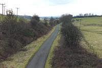 The station that never was - site of the proposed station at Castle Semple 37 years on [see image 32437]. View south from the Howwood - Lochwinnoch road bridge in January 2011 (the view north is obscured by tree growth). Castle Semple Loch can be seen in the middle distance.<br><br>[Colin Miller&nbsp;28/01/2011]