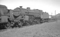 <I>Crab</I> 2-6-0 no 42861 standing amongst the abandoned locomotives in the sidings alongside Ayr shed on 31 July 1966, the precise date of its <I>official</I> withdrawal by BR.<br><br>[K A Gray&nbsp;31/07/1966]