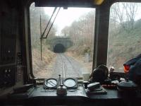 DMU driver's eye view of the south portal of Nuttall Tunnel on the East Lancashire Railway. The train is in the short cutting between Nuttall and the longer Brooksbottom Tunnel from where it will emerge on to Summerseat viaduct.  <br><br>[Mark Bartlett&nbsp;01/01/2011]
