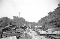 Clearance of wreckage and replacement of damaged track in progress in the cutting east of Grantshouse station following the Freightliner derailment of 15 July 1969 [see image 32491]. Photographed looking east into the cutting during the evening of the day following the crash. Clearance and relaying work had been completed by Saturday 19 July when normal operations were resumed.<br> <br><br>[Bill Jamieson&nbsp;16/07/1969]