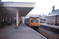 Platform scene at Llandrindod Wells on the Central Wales Line in the summer of 1971 - before the crossing loop was returned to the platform road opposite.<br> <br><br>[David Spaven&nbsp;//1971]