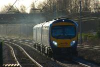 A First TransPennine service to Edinburgh speeds north along the WCML on the approach to Leyland on 3 February 2011. <br> <br><br>[John McIntyre&nbsp;03/02/2011]