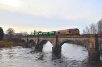 67007 crossing the viaduct over the River Conon with the tanker train for Lairg on 5 February 2011.<br> <br><br>[John Gray&nbsp;05/02/2011]