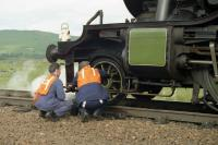 The crew of ex LNER K4 no 3442 <I>The Great Marquess</I> checking the pony truck of the locomotive during an extended station stop at Rannoch on 07 August 1994 whilst working the <I>West Highland Railway Centenary</I> special to Fort William.<br> <br><br>[John McIntyre&nbsp;07/08/1994]