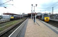 Looking north into York station on 16 July 2007. On the left is a GNER northbound service with a Class 91 on the rear while on the right a southbound HST is boarding.<br><br>[John McIntyre&nbsp;16/07/2007]