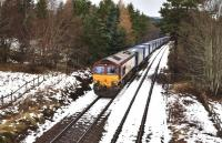 66120 hauls the Stobart Rail containers through the loop at Moy on 7 February. Just behind the tall tree on the right is one of the cut back platforms of Moy Station. (Closed 1965)<br> <br><br>[John Gray&nbsp;07/02/2011]
