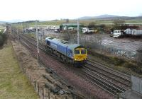 Freightliner 66623 in <I>'Bardon Aggregates'</I> blue livery approaches Carstairs South Junction on 5 February 2011.<br><br>[Ken Browne&nbsp;05/02/2011]