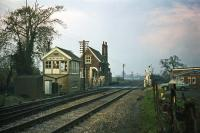 A Norwich to London express is due at Swainsthorpe level crossing on 14th November 1976. The station closed on 5th July 1954 and the building seen here was demolished not long after this photo was taken. The signal box can now be found at Wells at the terminus of the Wells and Walsingham narrow gauge railway.<br><br>[Mark Dufton&nbsp;14/11/1976]