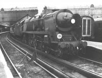 Merchant Navy Pacific no 35003 <I>Royal Mail</I> preparing to leave London's Waterloo station in August 1965 with a Bournemouth line service. The locomotive survived for a further two years before finally being withdrawn from Nine Elms shed in the summer of 1967.<br><br>[Jim Peebles&nbsp;/08/1965]
