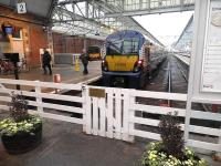 View out from the concourse at Helensburgh Central on 9 February with a blue class 334 at the buffer stops on platform 2.<br><br>[John Yellowlees&nbsp;09/02/2011]
