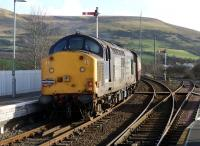 DRS locomotive no 37601 brings up the rear of the Pathfinder Tours <I>Galloway Galloper</I> as it leaves Girvan for Stranraer on Saturday 12 February 2011. (DRS 37607 was on the front of the special.) [See image 32756]<br><br>[Colin Miller&nbsp;12/02/2011]