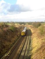 A Northern service from Leeds to Blackpool North has just climbed <br> Hoghton bank and is now rounding the curve towards the former Hoghton station on 12 February 2011. The city of Preston is just visible on the skyline.<br><br>[John McIntyre&nbsp;12/02/2011]