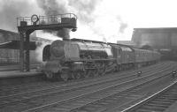Stanier 'Coronation' Pacific no 46225 <I>Duchess of Gloucester</I> awaits her departure time from Carlisle's platform 3 on Saturday 31 August 1963. The locomotive has just taken charge of the 9am Perth - Euston train.<br><br>[K A Gray&nbsp;31/08/1963]