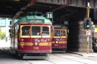 Two City Circle W-class trams pass in Flinders Street on 7 October 2008. This free service for tourists also attracts the locals. The bridge carries the railway lines linking Flinders Street Station to Spencer Street, now called Southern Cross.<br> <br><br>[Colin Miller&nbsp;07/10/2008]