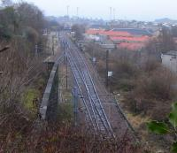 Abbeyhill Junction is where the bidirectional lines from the east of <br> Waverley Station through Calton tunnels (just one track per tunnel) <br> resolve into the Up and Down ECML. In the middle distance the Abbeyhill Loop and line to Leith once also veered off to the left, but the connection was broken in the early 1990s. View east from Regent Road park on 12 February with the floodlights of Meadowbank Stadium on the horizon.<br><br>[David Panton 12/02/2011]