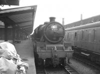 Jubilee 4-6-0 no 45697 <I>Achilles</I> stands alongside Carlisle platform 1 having just brought in train 1S43, a Leicester - Gourock working, on Saturday 7 August 1965.<br><br>[K A Gray&nbsp;07/08/1965]