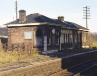 The board on the west end wall of Duddingston and�Craigmillar station (closed 1962) proclaims that it deals with goods and parcels traffic but the dilapidated condition of the building suggests� <br> otherwise. Photographed on Sunday 22nd November 1970.<br> <br><br>[Bill Jamieson&nbsp;22/11/1970]