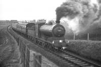 The SLS <I>'Farewell to Peebles'</I> railtour with J37 0-6-0 no 64587 in charge captured shortly after leaving Pomathorn en route to its next stop at Leadburn on Saturday 3rd February 1962, the last day of passenger services over the line. Pomathorn paper Mill (closed in 1975) can be seen in the left background [see image 23614]. <br><br>[Frank Spaven Collection (Courtesy David Spaven)&nbsp;03/02/1962]
