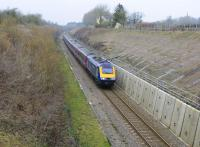 A First Great Western HST southbound, one mile out of Kemble Station heading towards Swindon on 22 February 2011. Note the repairs to the previously collapsed embankment so vividly shown in the image. Neither a classic nor a traditional repair, but very effective.<br> <br><br>[Peter Todd&nbsp;22/02/2011]