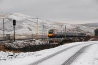 A southbound Pendolino passes Bodsbury Level Crossing.<br><br>[Ewan Crawford&nbsp;15/02/2011]