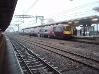 View north at Nuneaton in February 2011 as a CrossCountry service from Stansted Airport to Birmingham New Street calls at the station's new east side island platform. After leaving, 170107 will then climb to cross the WCML flyover in the distance before turning west towards Birmingham.<br><br>[Mark Bartlett&nbsp;23/02/2011]