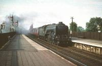 The unique A3 with full size smoke deflectors no 60097 <I>Humorist</I> leaves the Forth Bridge in August 1959 and runs south through Dalmeny heading for Waverley.  <br><br>[A Snapper (Courtesy Bruce McCartney)&nbsp;08/08/1959]