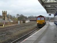 DBS 66119 northbound through Kilmarnock station on 23 February 2011 with the 4S90 Drax - New Cumnock empties heading for Long Lyes.<br><br>[Ken Browne&nbsp;23/02/2011]